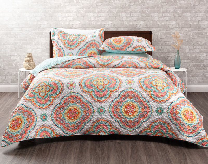 The Marigold Coverlet Set, featuring turquoise and orange mandalas on a white background.