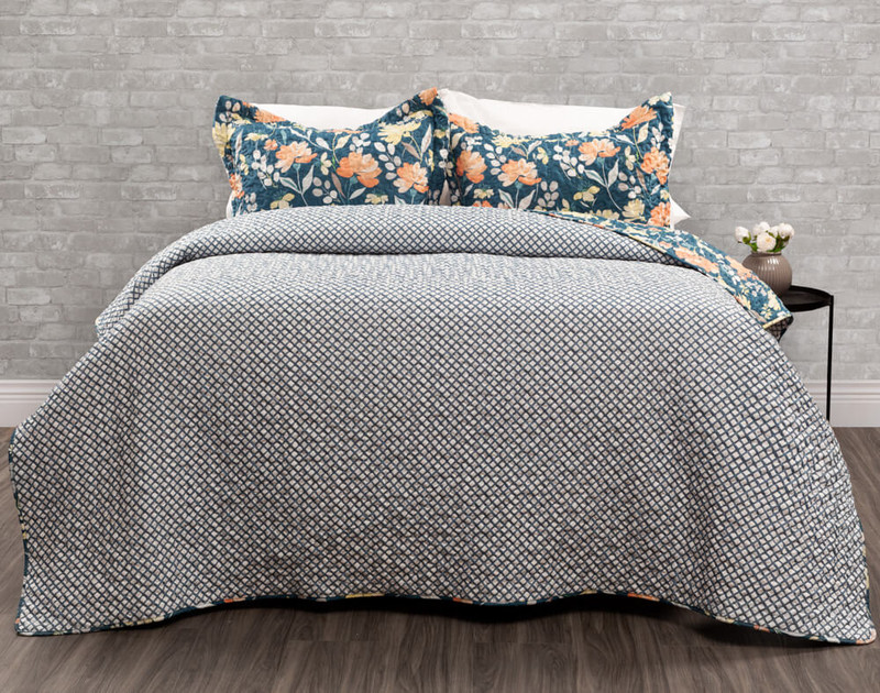 Ladysmith Coverlet Set reverses to a white background overlaid by a petrol blue angled grid print.