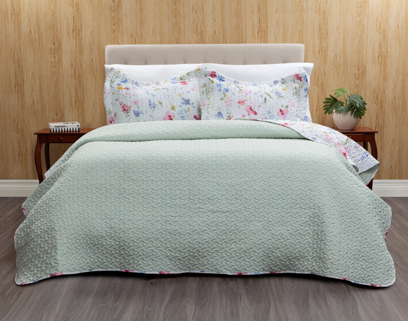 Larkfield Coverlet Set reverses to a pale mint green.