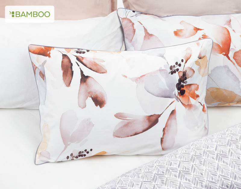 Bergen Pillowsham in a bed with reversed Bergen duvet cover