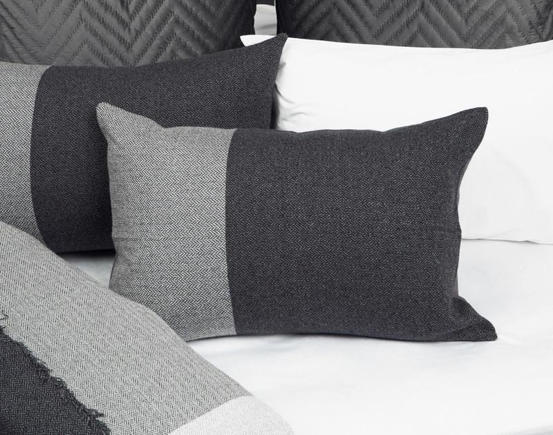 Thoren Pillow Sham laying on half-open bedding.