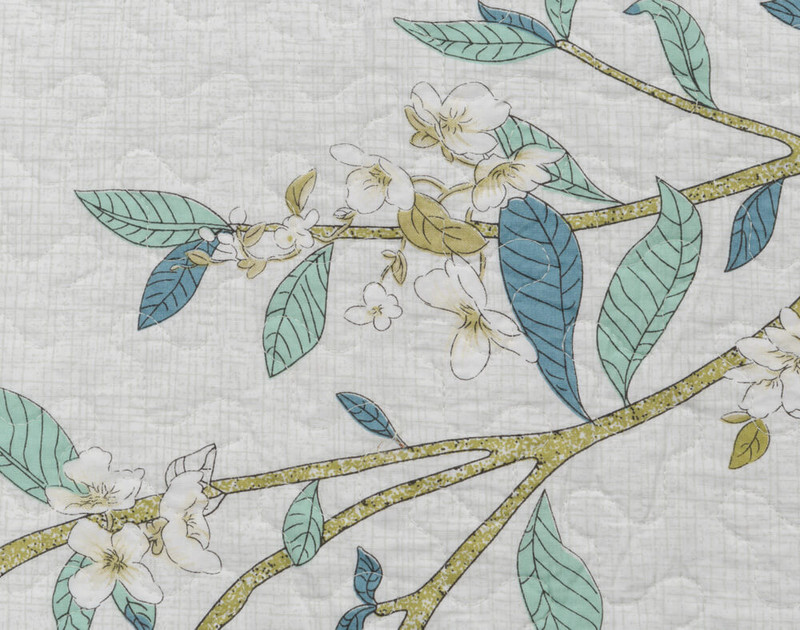 Close up of floral details with intricate white floral buds