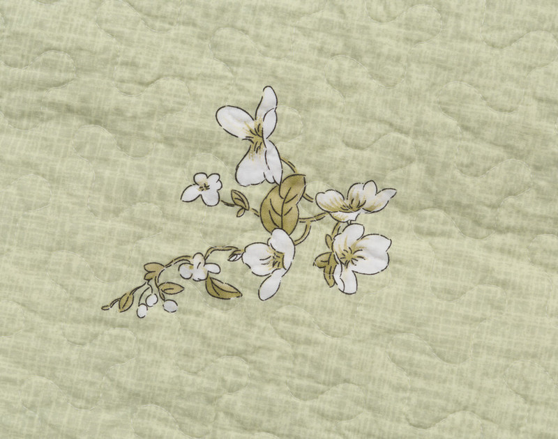 Reverse side of Josette Quilt set with intricated white bloom details.