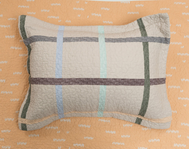 Simco Pillow Sham displayed on the reverse side of the quilt set, a delicate peach