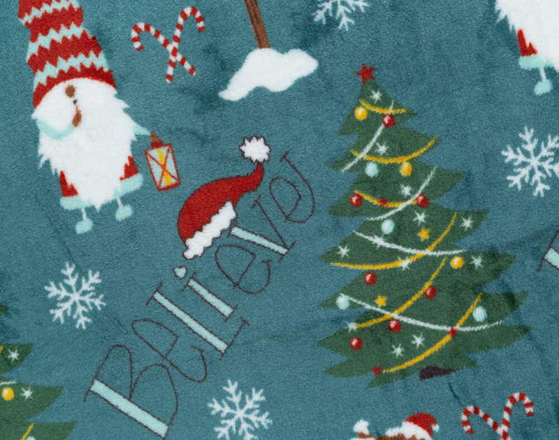 Close-up of Believe Holiday Throw Pattern with Santa Hats, Elves, and Trees.