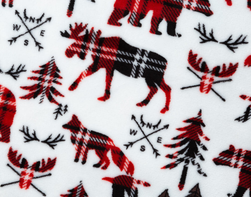 Close-up of Wilderness Plaid Holiday Throw Pattern with plaid moose and foxes on a white background.