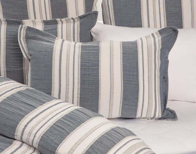 Truro Pillow Sham in shades of indigo grey on bed