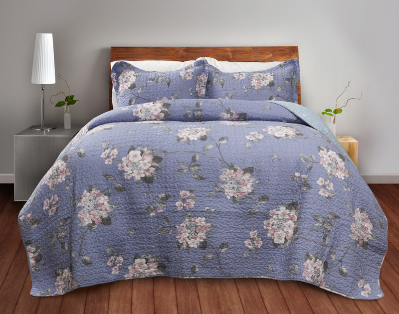 Swallowtail Cotton Quilt Set features sweet pink flowers on a powder blue background.