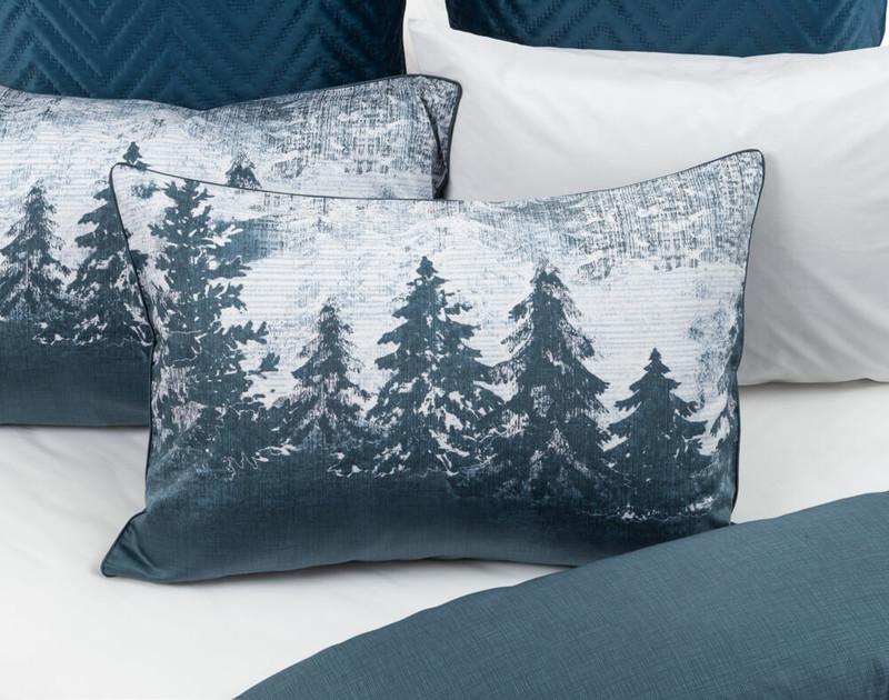 Alps Pillow Sham sitting over white bedding.