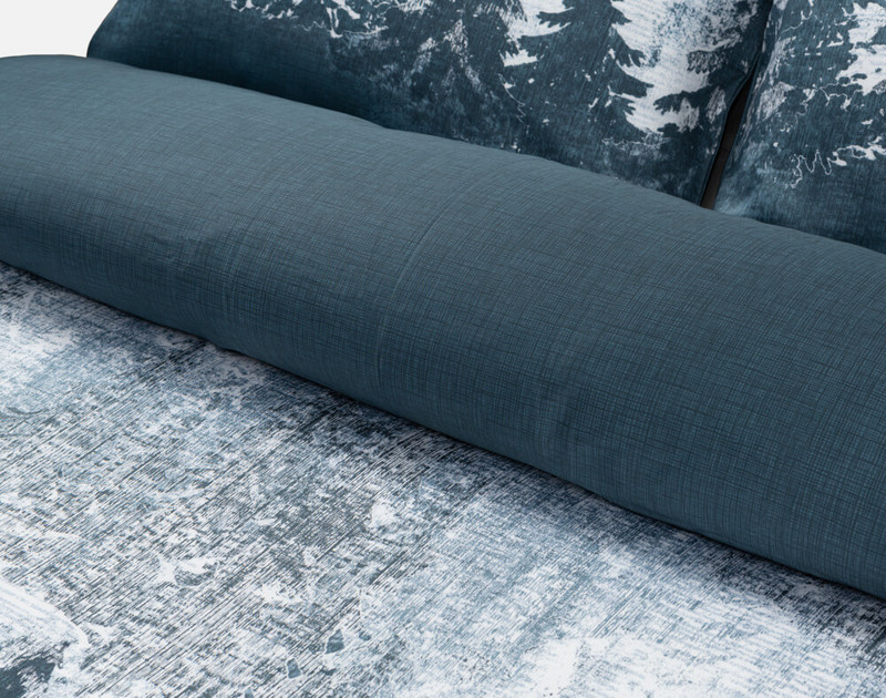 Close-up of the folded Alps Duvet Cover to show its dark reverse.