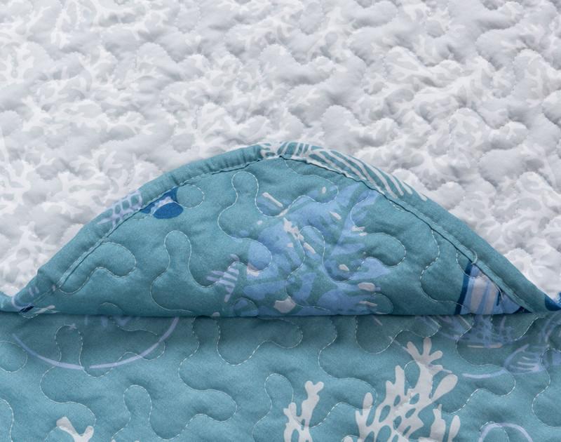 Close up of Shells Coverlet Set seams.