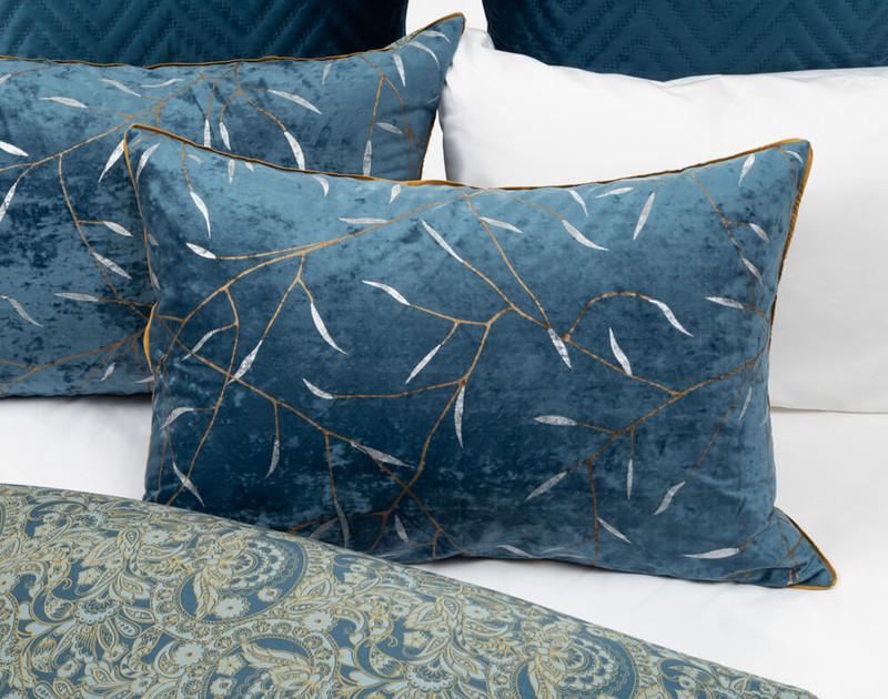 Charisma Pillow Sham laid over white bedding.