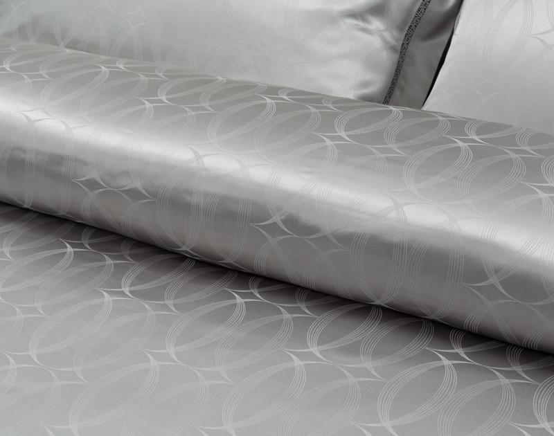 View of Armoire Silk blend duvet cover set circular jacquard pattern