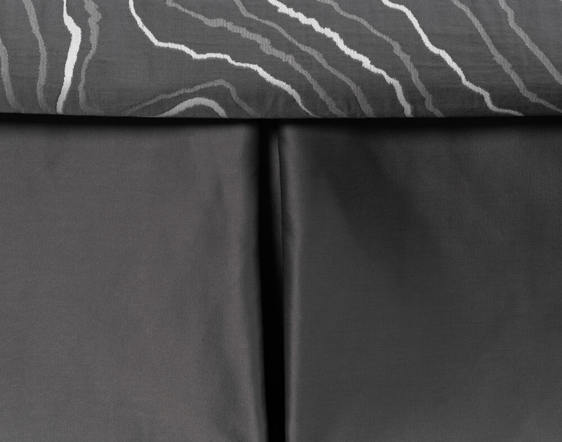 Close-up of the coordinating Palisade Black Bed Skirt.
