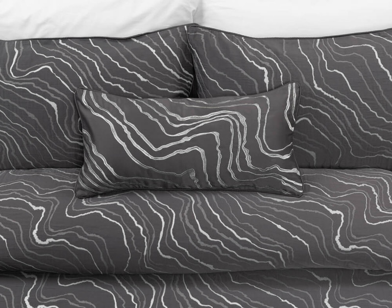 Palisade Black Boudoir Pillow Cover laying over matching Duvet Cover and Pillow Shams.