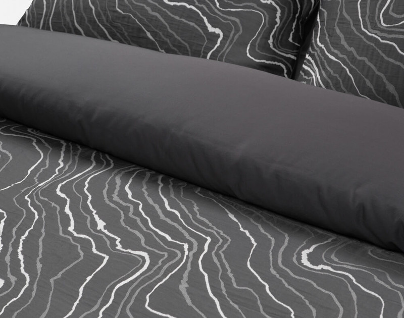Folded edge of Palisade Duvet Cover to show its solid reverse.