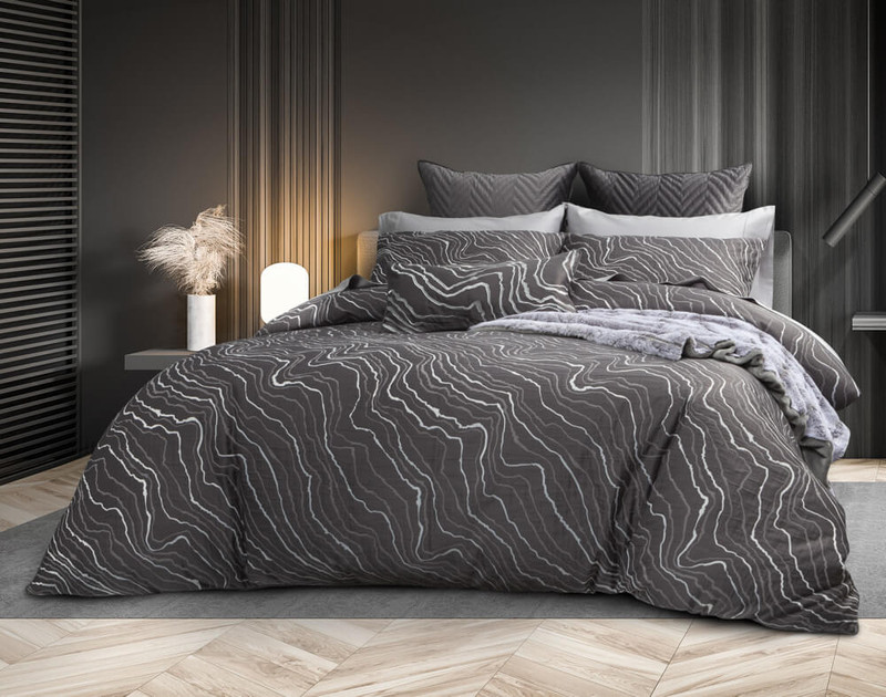 Angled view of Palisade Black Duvet Cover in a dark classic room.