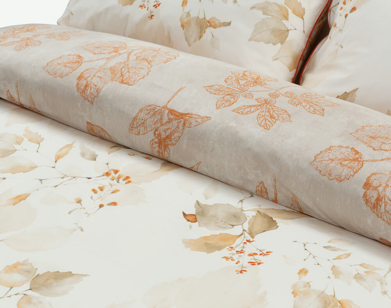 Close-up of the folded Woodhaven Duvet Cover to show its front and reverse.