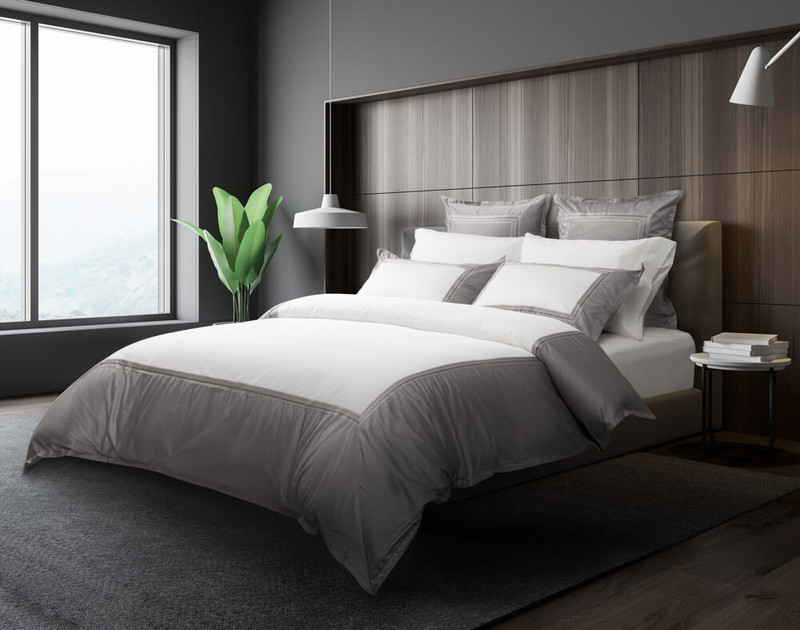 Angled view of Hatfield Duvet Cover and Bedding Collection in a dark modern bedroom.