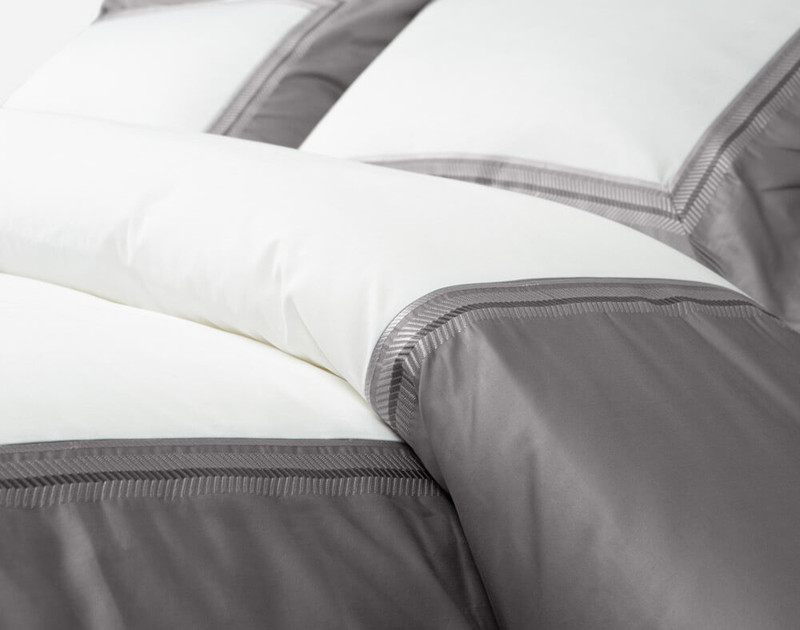 Close-up of Hatfield Duvet Cover dressed and folded over a bed.