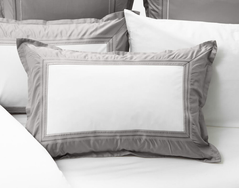 Hatfield Pillow Sham laying over white sheeting and Hatfield Bedding Collection.