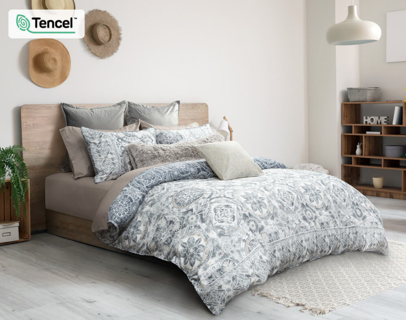 Sonesta Duvet Cover side angle, featuring a medallion print in White, Grey, Blue and Beige