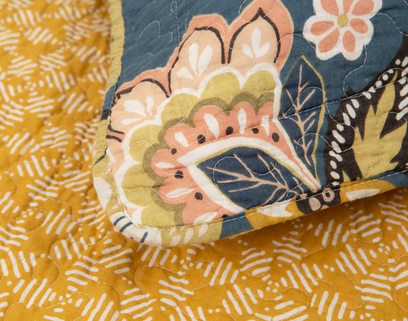 Close-up of the Amita Cotton Quilt Set edge.