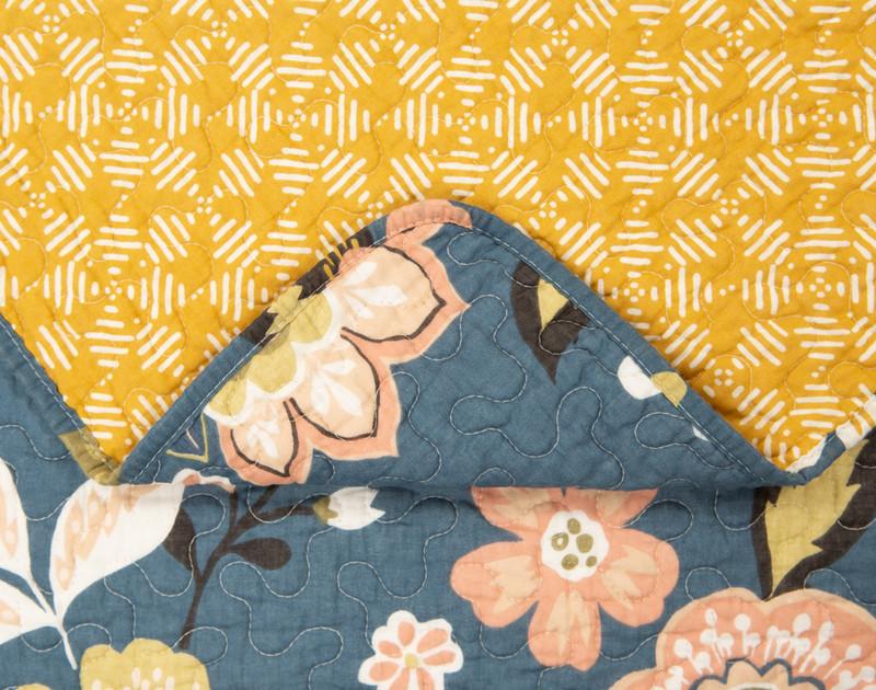 Folded corner of the Amita Cotton Quilt Set.