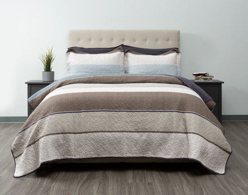 The Baxter Cotton Quilt Set features a modern striped pattern, and reverses to a deep grey.