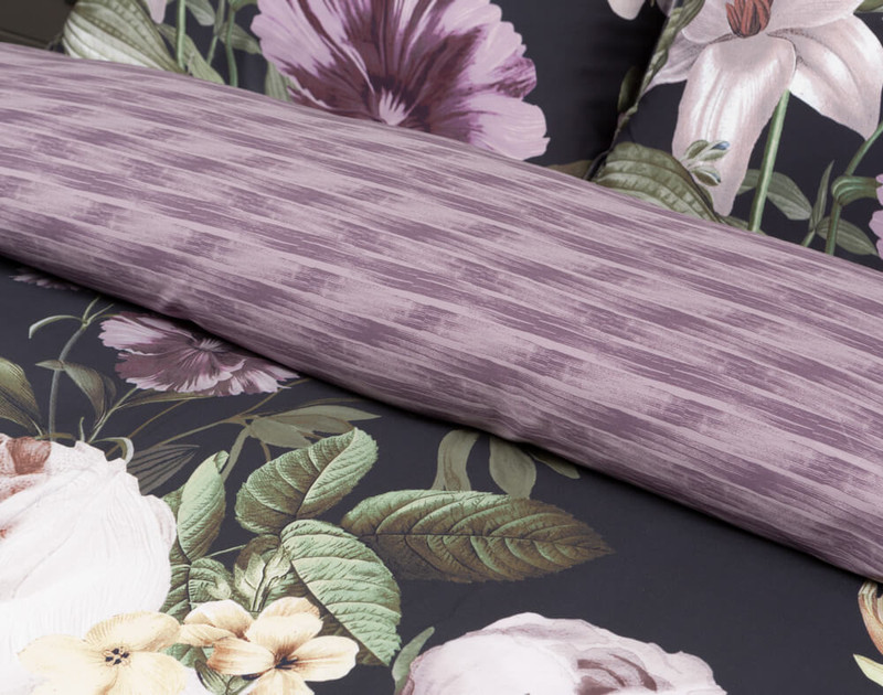 Close-up of the folded Greta Floral Duvet Cover to show its purple pattern reverse.