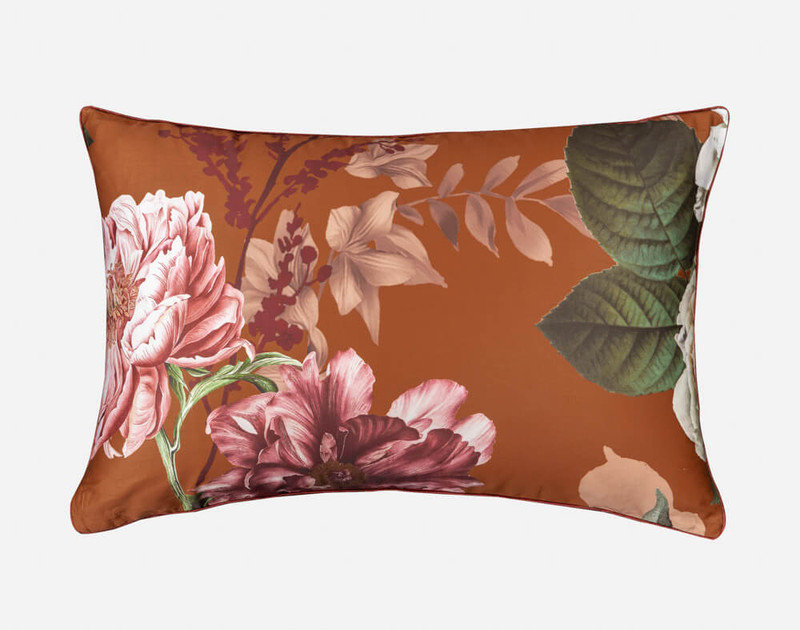 Lillith Pillow Sham, featuring peonies and greenery on a vibrant Amber background.