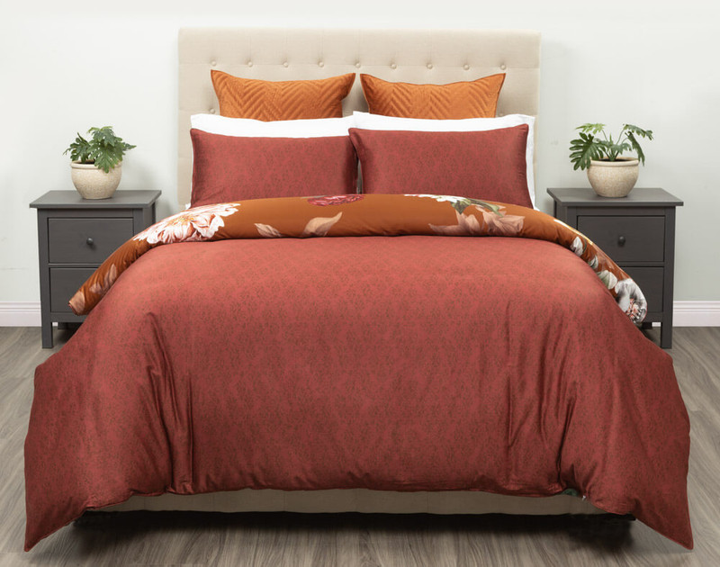 Reverse side of Lillith Duvet Cover and shams displaying a rich Auburn.