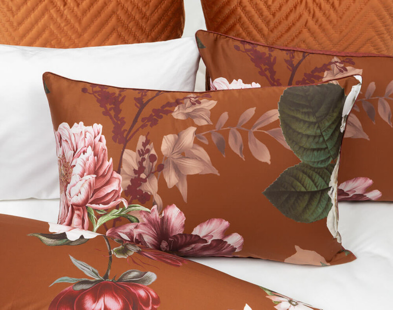 Lillith Pillow Sham displayed against a White Bamboo Cotton Sheet Set.