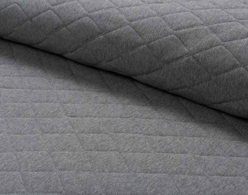 Folded Chevron Jersey Quilt Set to show its soft texture and flexibility.