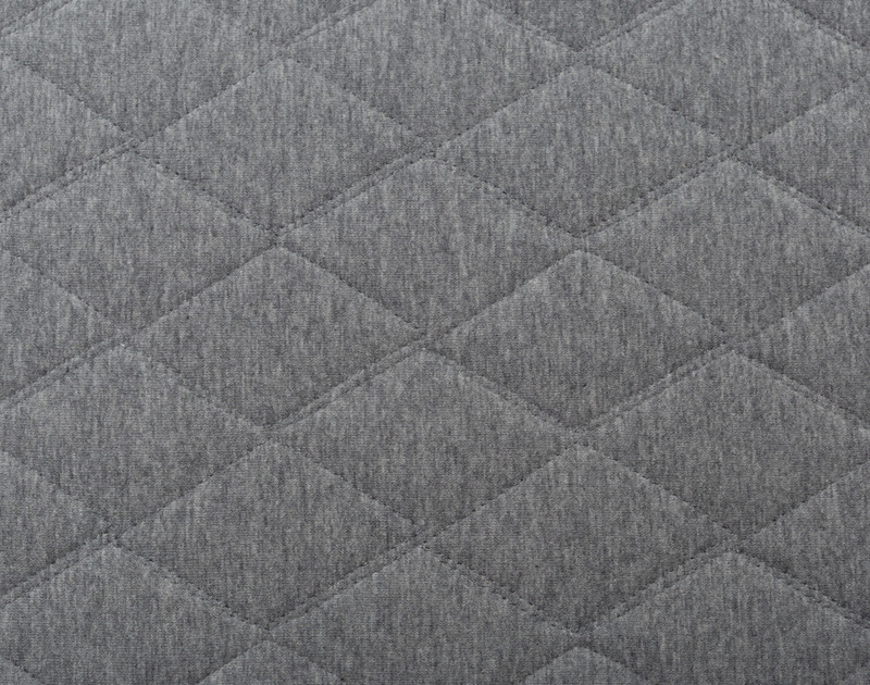 Close-up of the textured diamond top stitch pattern of our Chevron Jersey Quilt Set.