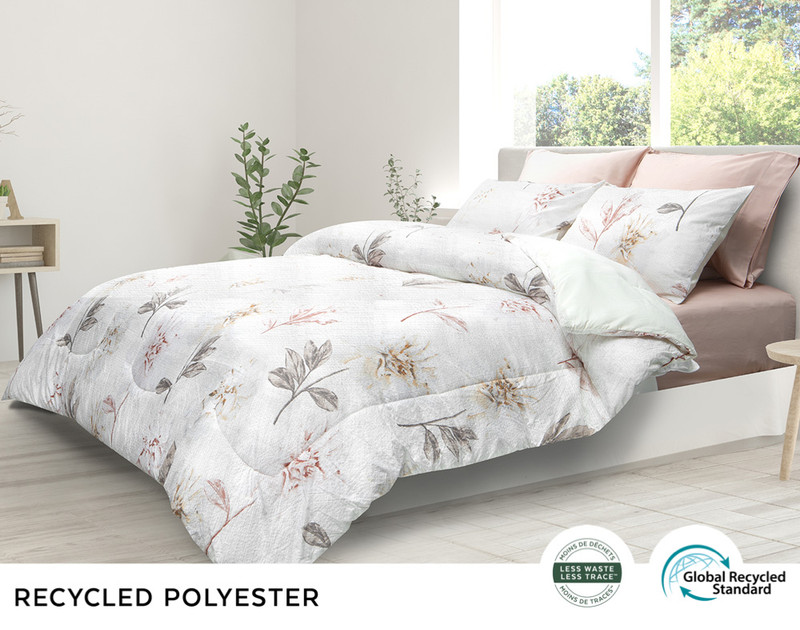 Brielle comforter set, side view. Shown in shades of white with delicate florals