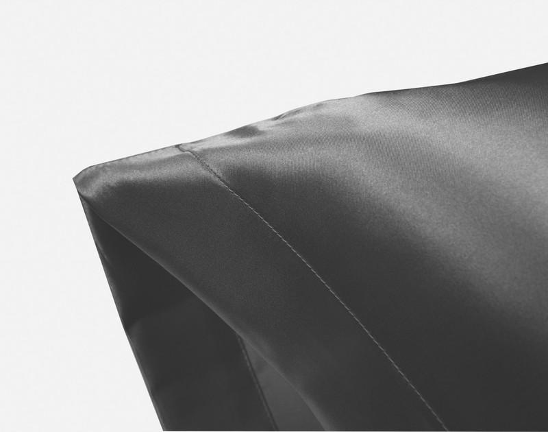 Corner of an Charcoal Satin Pillowcase showing envelope fold