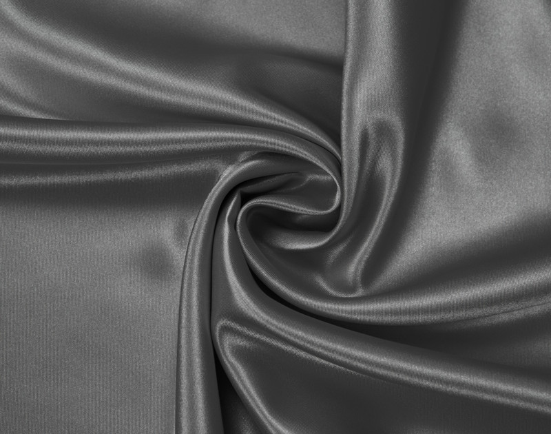 Close-up of Charcoal Satin Pillowcase with fabric curved