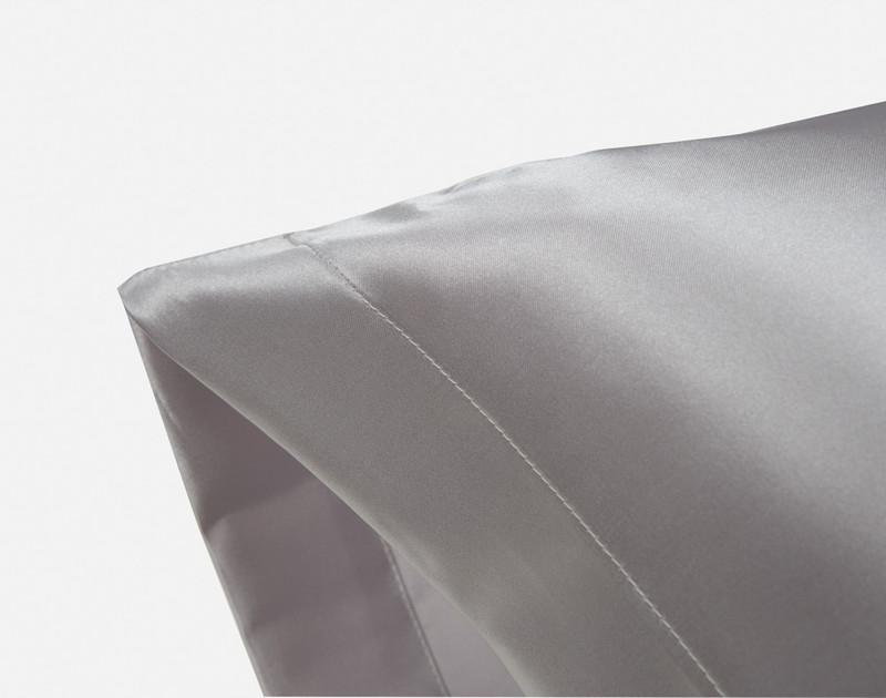 Corner of an Silver Satin Pillowcase showing envelope fold