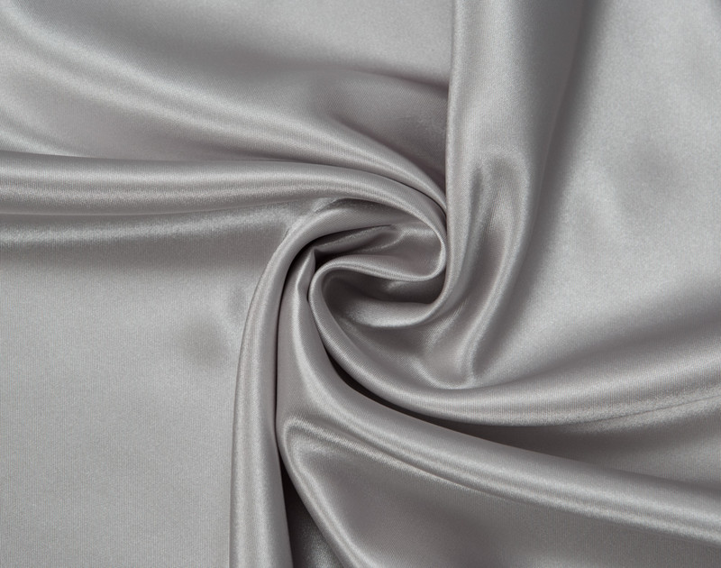 Close-up of Silver Satin Pillowcase with fabric curved