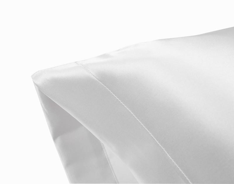 Corner of an White Satin Pillowcase showing envelope fold