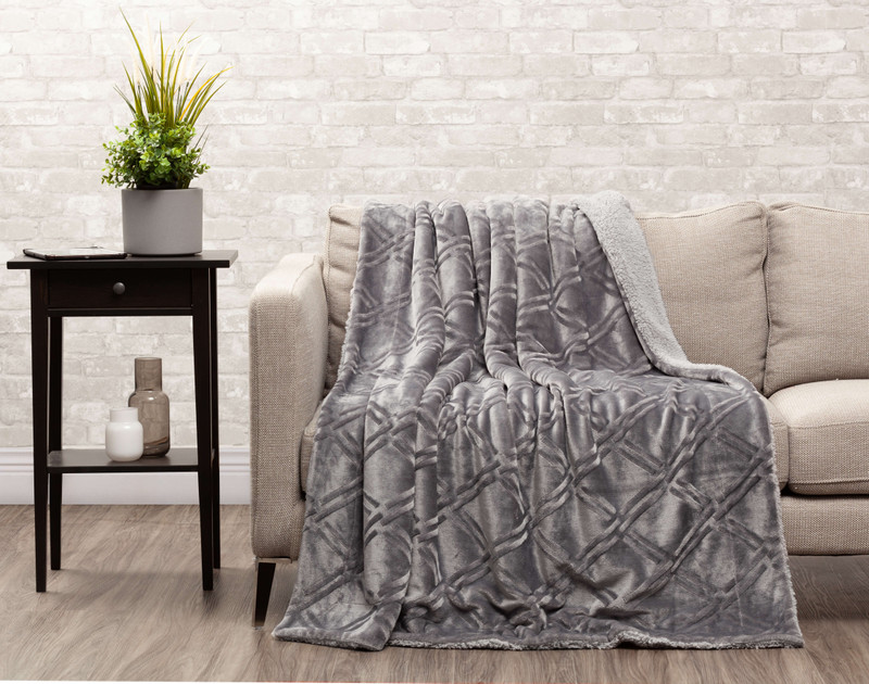 Charcoal Diamond Etched Throw draped over a couch