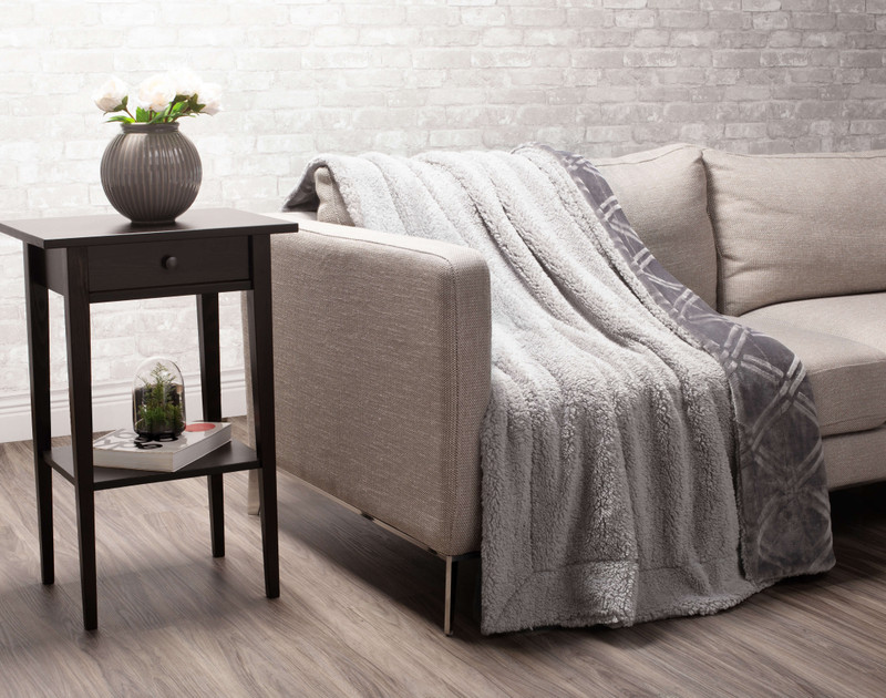 Charcoal Diamond Etched Throw draped to reverse over a couch