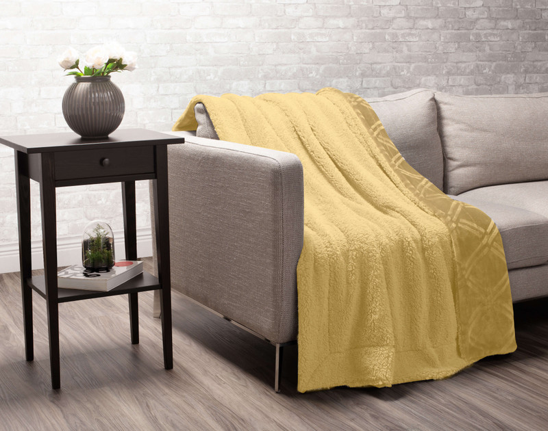 Gold Diamond Etched Throw draped to reverse over a couch