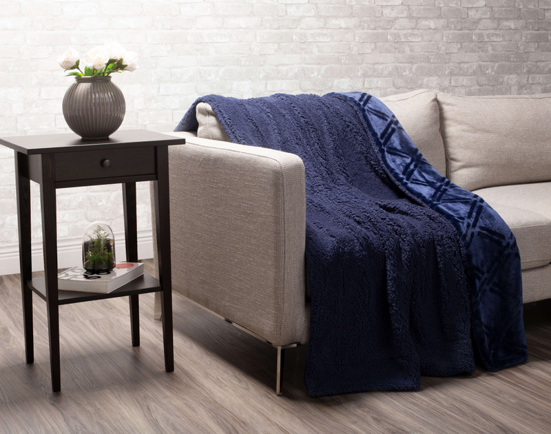 Indigo Diamond Etched Throw draped to reverse over a couch