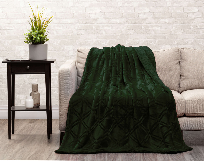 Rainforest Diamond Etched Throw draped over a couch