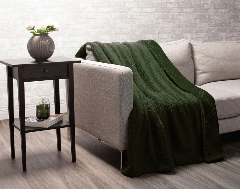 Rainforest Diamond Etched Throw draped to reverse over a couch