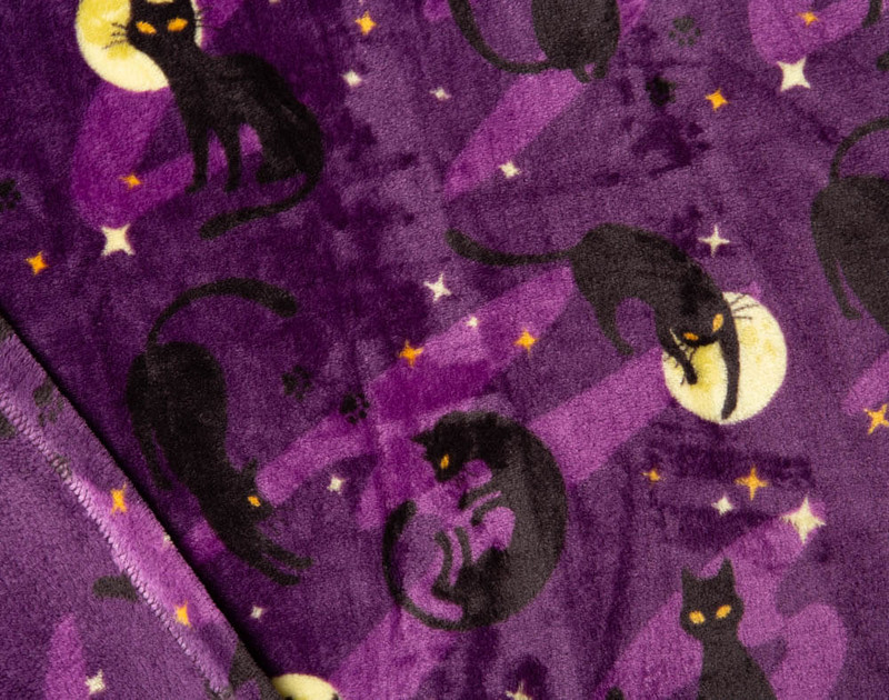 Close-up of Halloween Black Cat Fleece Throw pattern of cats and moons.