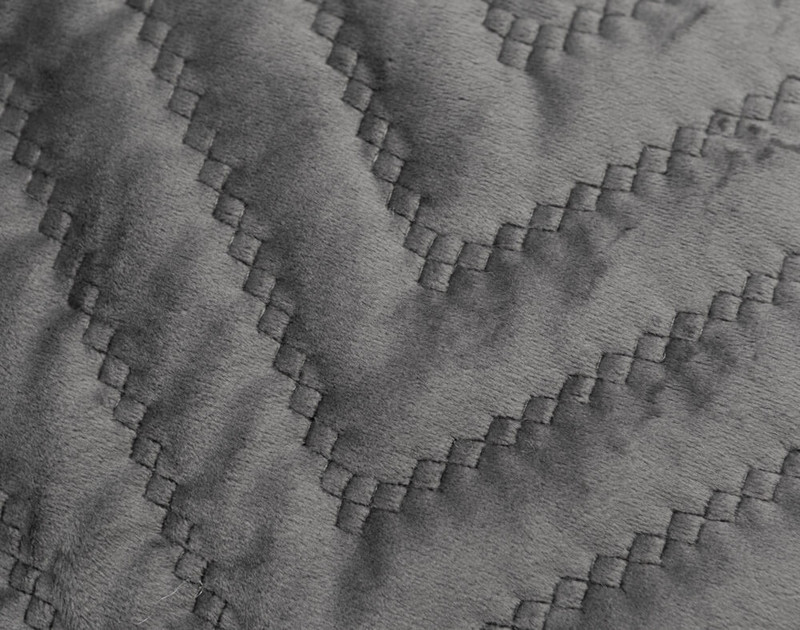 Close-up of the quilted texture of our Quilted Chevron Euro Sham in Charcoal.