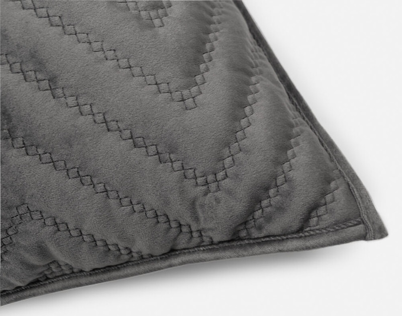 One closed corner of our Quilted Chevron Euro Sham in Charcoal.